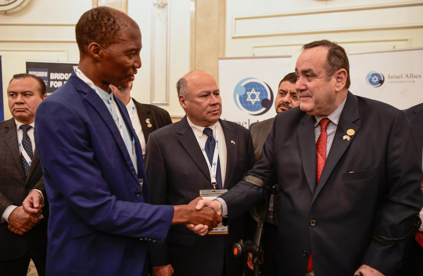 Bishop Scott Mwanza shakes hands with Guatemala's president-elect Alejandro Giammattei at a recent Israel Allies Foundation event (photo credit: Courtesy)