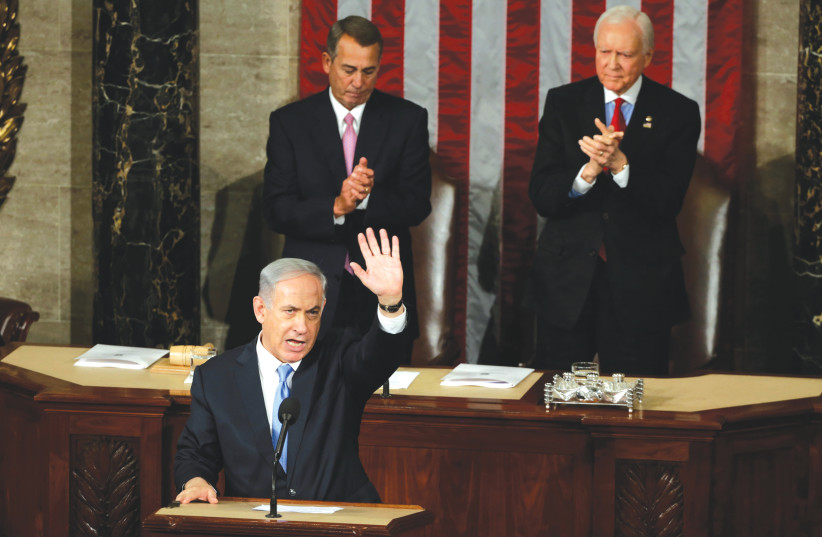 PRIME MINISTER Benjamin Netanyahu acknowledges applause at the end of his speech to a joint session of Congress in Washington on March 3, 2015. (photo credit: REUTERS/GARY CAMERON)