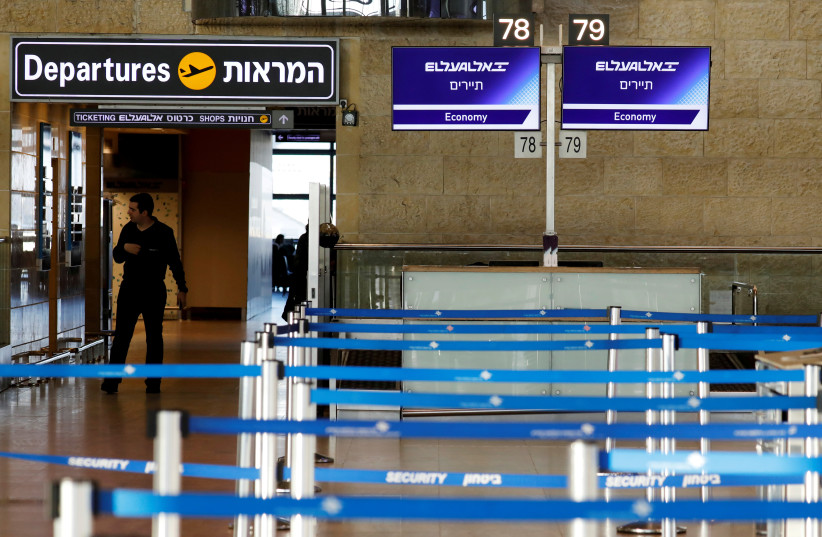 Empty El Al Israel Airlines check-in counters are seen at Ben Gurion International airport in Lod, near Tel Aviv, Israel February 27, 2020. (photo credit: AMIR COHEN/REUTERS)