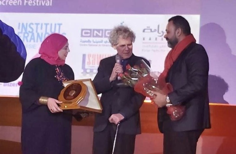 Jack Baxter (center) accepts the 'Prix de l'Espoir' (Prize of Hope) award at the closing ceremony of the 6th International Human Rights Film Festival of Tunis last month. (photo credit: JACK BAXTER)