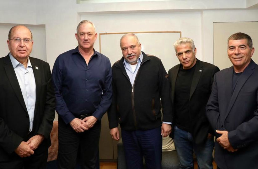 Yisrael Beytenu chairman Avigdor Liberman [C] with Blue and White top ranking officials [from Left to Right] Moshe Ya'alon, party leader Benny Gantz, Yair Lapid, Gabi Ashkenazi (photo credit: ELAD MALKA)