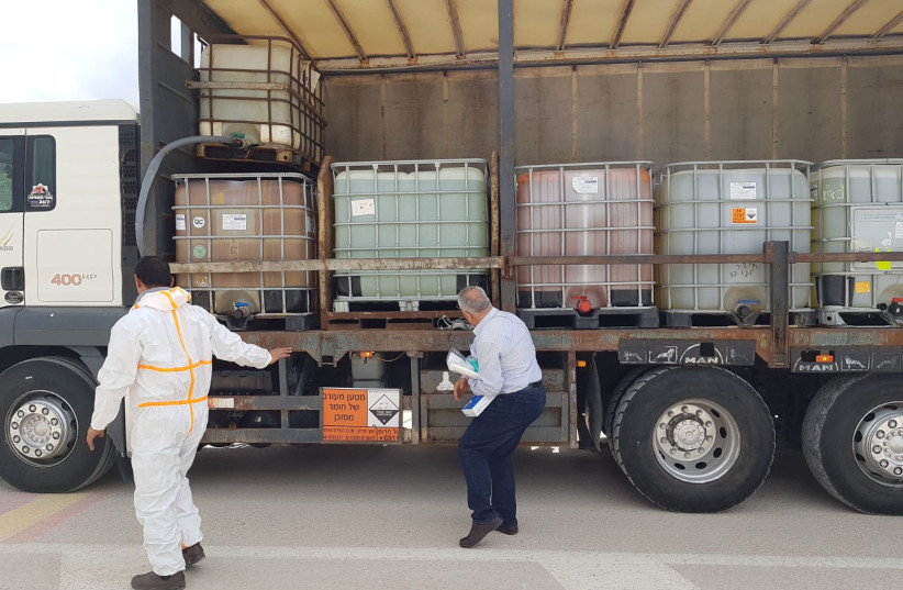 COGAT coordinate the delivery of 20 tons of disinfectant during the coronavirus outbreak (photo credit: COGAT SPOKESPERSON'S UNIT)