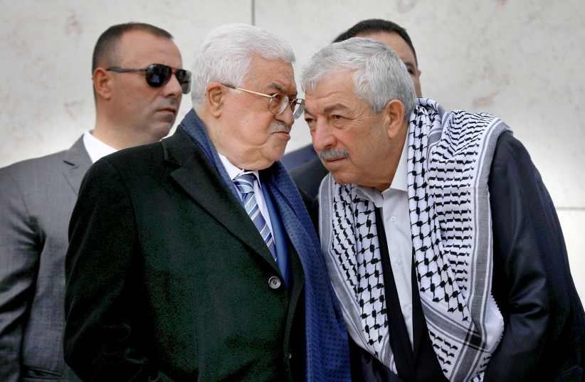 ABBAS CONFERS with senior Fatah official Mahmoud Aloul (right) during a ceremony marking the anniversary of the death of late PLO leader Yasser Arafat, in Ramallah on November 11, 2018. (photo credit: REUTERS)