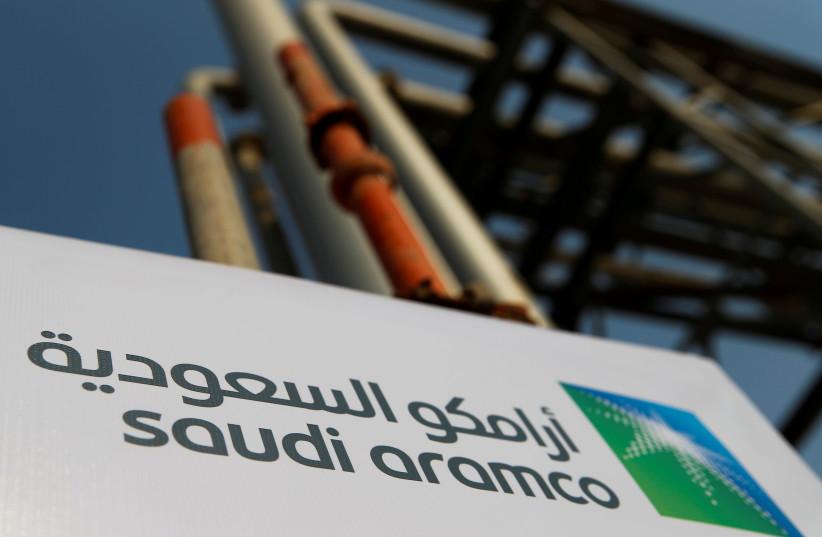 Saudi Aramco logo is pictured at the oil facility in Abqaiq, Saudi Arabia October 12, 2019 (photo credit: REUTERS/MAXIM SHEMETOV)