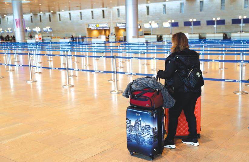A PASSENGER at Ben-Gurion Airport heads home to quarantine. (photo credit: RONEN ZVULUN/REUTERS)