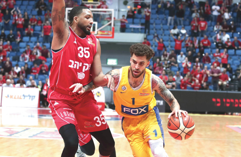 TASHAWN THOMAS (left) and Hapoel Jerusalem advanced to the Champions League quarterfinals on Wednesday night, while Scottie Wilbekin (right) and Maccabi Tel Aviv had their Euroleague campaign suspended due to coronavirus. (photo credit: DANNY MARON)