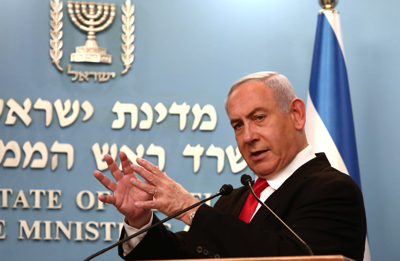Israeli Prime Minister Benjamin Netanyahu gestures as he delivers a speech at his Jerusalem office, regarding the new measures that will be taken to fight the coronavirus, March 14, 2020 (photo credit: GALI TIBBON POOL/REUTERS)