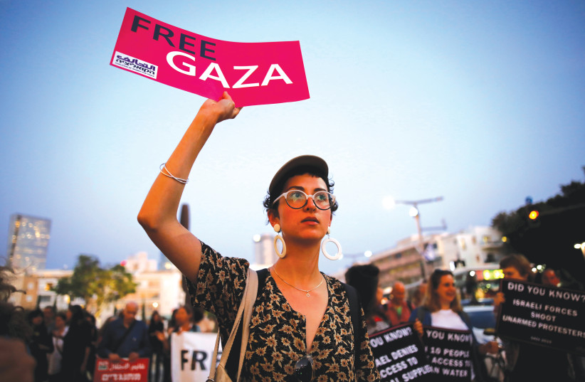 AN ANTI-ISRAEL protester demonstrates against the Eurovision Song Contest. (photo credit: REUTERS)