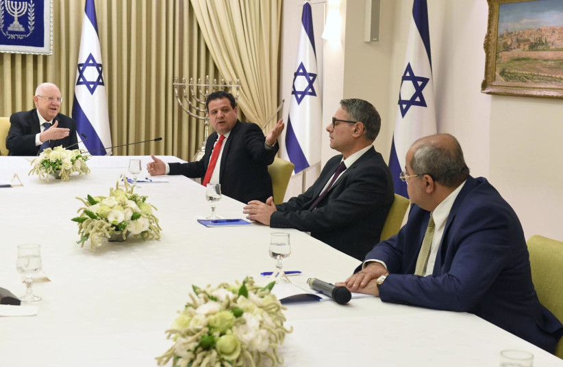 President Reuven Rivlin meets with representatives of the Joint List on March 15, 2020 (photo credit: Mark Neiman/GPO)