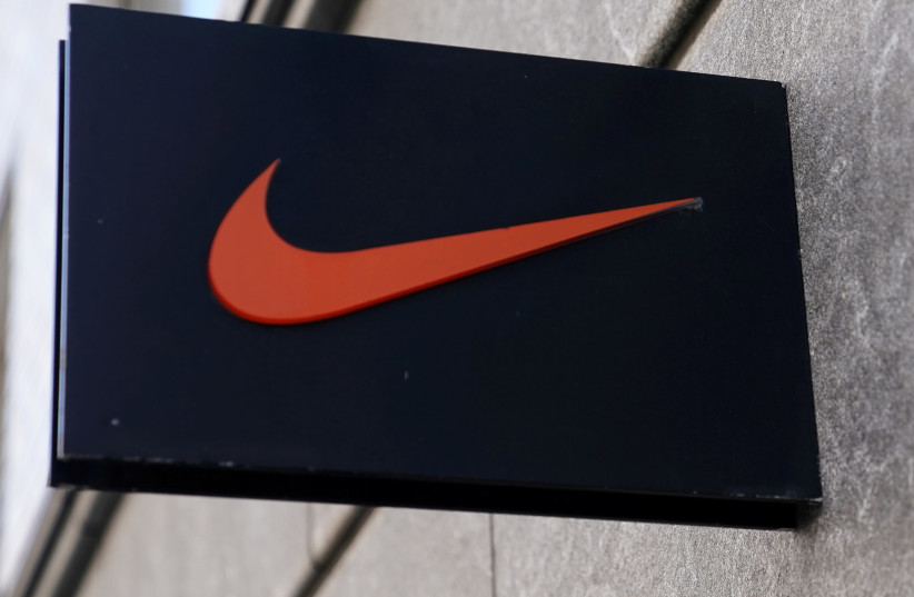 The Nike swoosh logo is pictured on a store in New York City, New York, U.S., September 4, 2018 (photo credit: REUTERS/CARLO ALLEGRI)