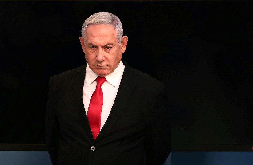 Israeli Prime Minister Benjamin Netanyahu arrives for a speech at his Jerusalem office, regarding the new measures that will be taken to fight the coronavirus, March 14, 2020 (photo credit: REUTERS/GALI TIBBON/POOL)