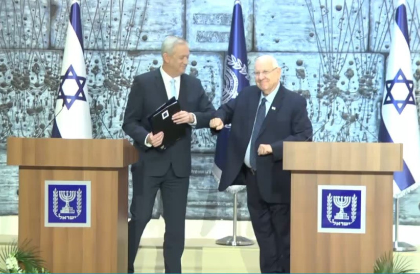 Blue and White leader Benny Gantz receives mandate to form a government from President Reuven Rivlin as they avoid shaking hands due to the coronavirus outbreak (photo credit: GOVERNMENT PRESS OFFICE)
