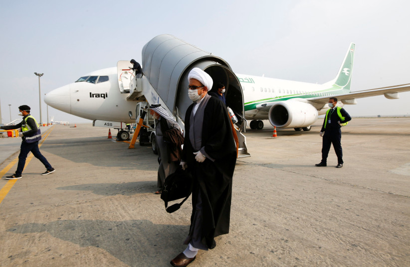 A cleric man wears a protective mask amid concerns over the coronavirus (COVID-19) spread, at Najaf airport in the holy city of Najaf upon his arrival from Iran (photo credit: REUTERS/ALAA AL-MARJANI)