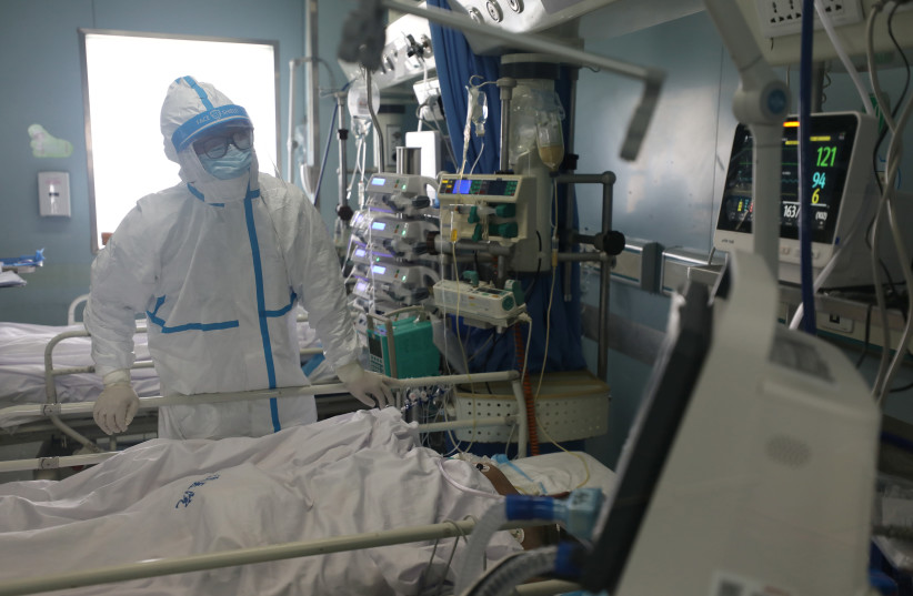 Medical worker is seen at the intensive care unit (ICU) of Jinyintan hospital in Wuhan, the epicentre of the novel coronavirus outbreak (photo credit: REUTERS)