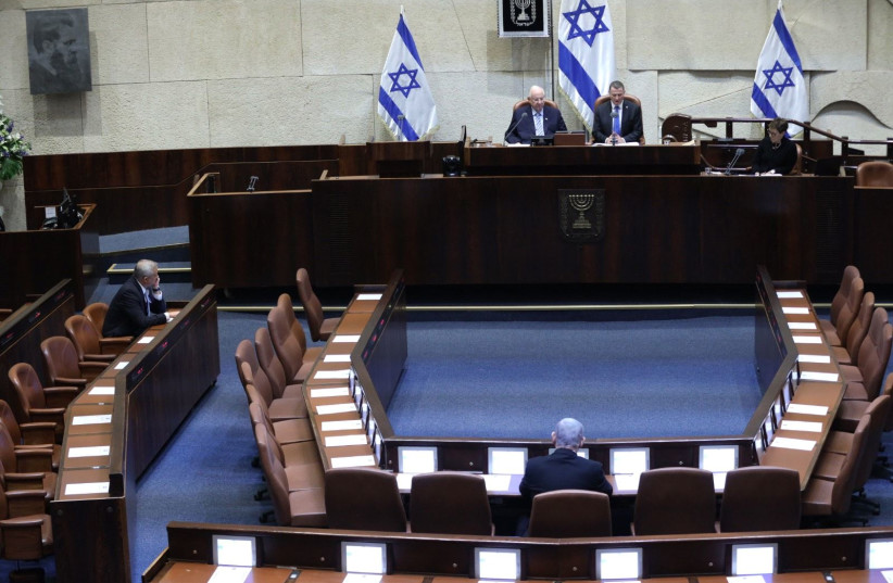 Blue and White leader Benny Gantz (L) and Prime Minister Benjamin Netanyahu (C) sit in an empty hall in front of President Reuven Rivlin and Knesset Speaker Yuli Edelstein at the swearing in of the 23rd Knesset, March 16, 2020 (photo credit: HAIM ZACH/GPO)