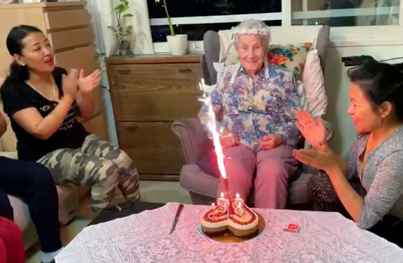 Ester Wienrib, an Israeli Holocaust survivor celebrates her 97th birthday with her caretaker and friends at her assisted living facility in Tel Aviv (photo credit: REUTERS TV)