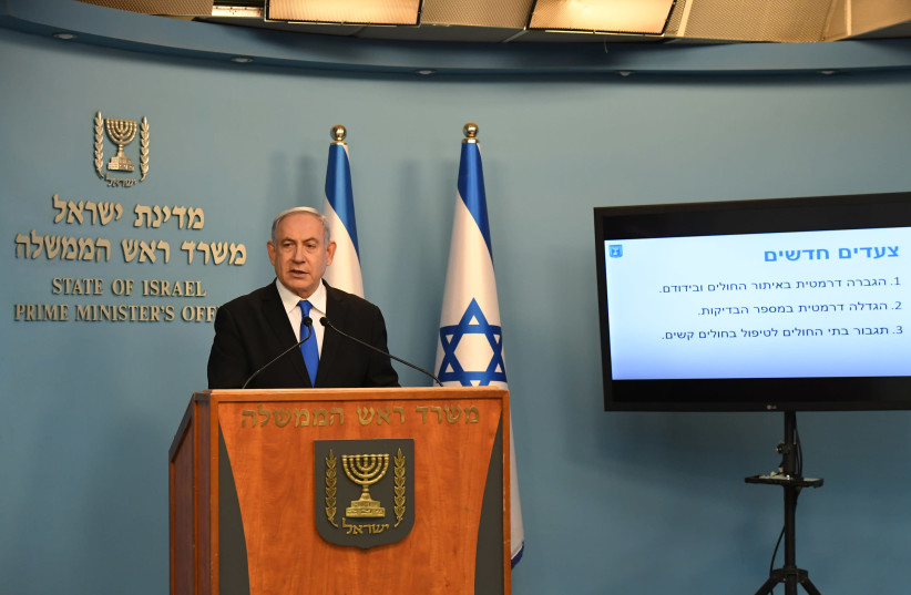 Prime Minister Benjamin Netanyahu is seen addressing the State of Israel with updates to the ongoing coronavirus outbreak. (photo credit: KOBI GIDEON/GPO)