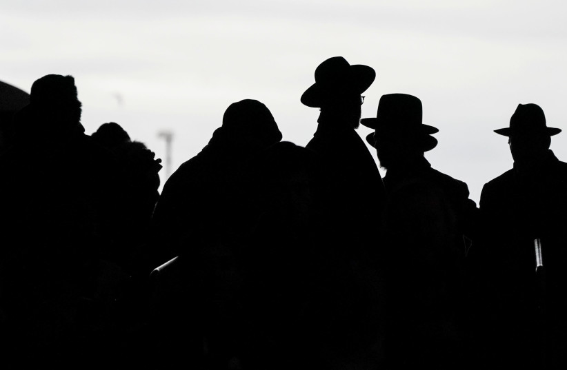 Orthodox Jews arrive during the 13th Siyum HaShas, a celebration marking the completion of the Daf Yomi, a seven-and-a-half-year cycle of studying texts from the Talmud, the canon of Jewish religious law, at the MetLife Stadium in East Rutherford, New Jersey, U.S. (photo credit: REUTERS/JEENAH MOON)