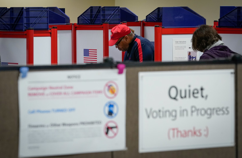 Voters fill in their ballot during a period of early voting at the Board of Elections office in Cincinnati, Ohio, U.S. March 14, 2020 (photo credit: BRYAN WOOLSTON/REUTERS)