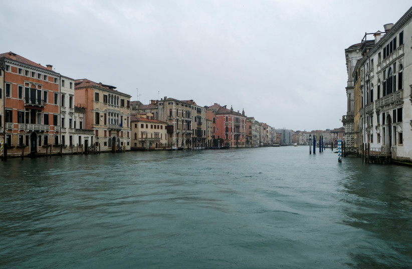 An empty canal is seen after the spread of coronavirus has caused a decline in the number of tourists in Venice, Italy, March 1, 2020 (photo credit: REUTERS/MANUEL SILVESTRI)