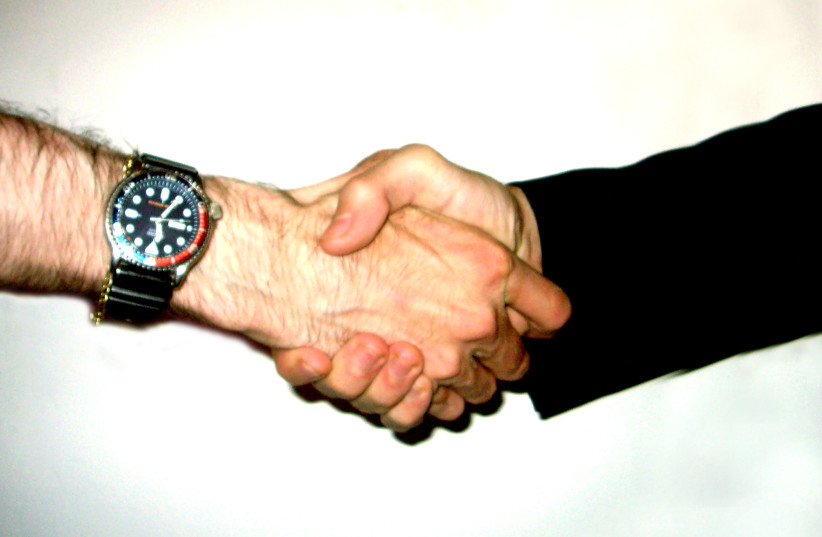 IN THIS new time, shaking hands has been replaced with rubbing elbows. (photo credit: Wikimedia Commons)