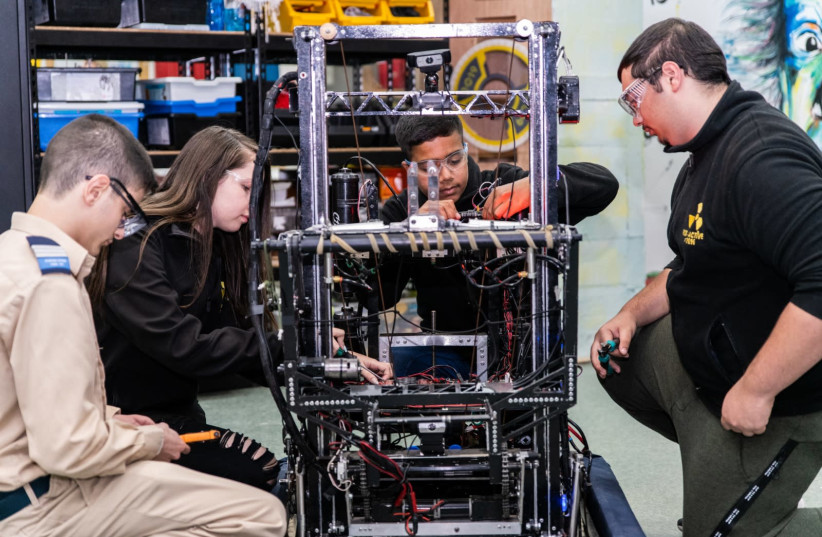 HARD AT work on a robotics project: World ORT students in Dimona. (photo credit: WORLD ORT)
