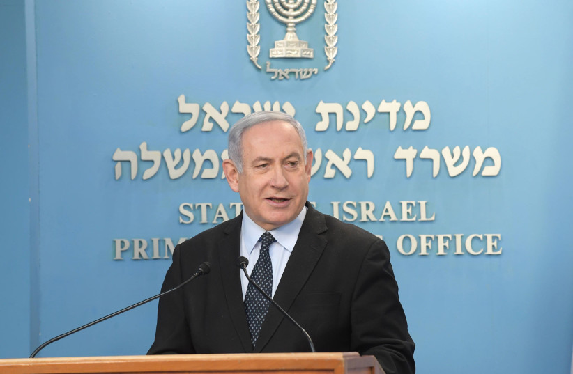Prime Minister Benjamin Netanyahu addresses the nation on the coronavirus outbreak, March 19, 2020 (photo credit: AMOS BEN-GERSHOM/GPO)