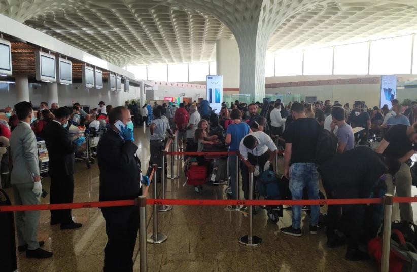 Israelis stranded in India board a special El Al flight to return them to Israel amid the coronavirus outbreak. (photo credit: EL AL)
