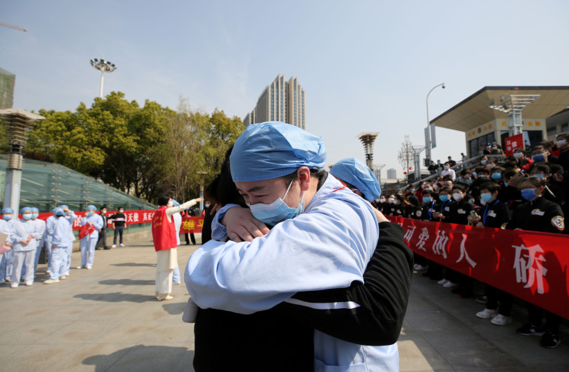 CHINA PIONEERED the struggle against the virus. (photo credit: REUTERS)