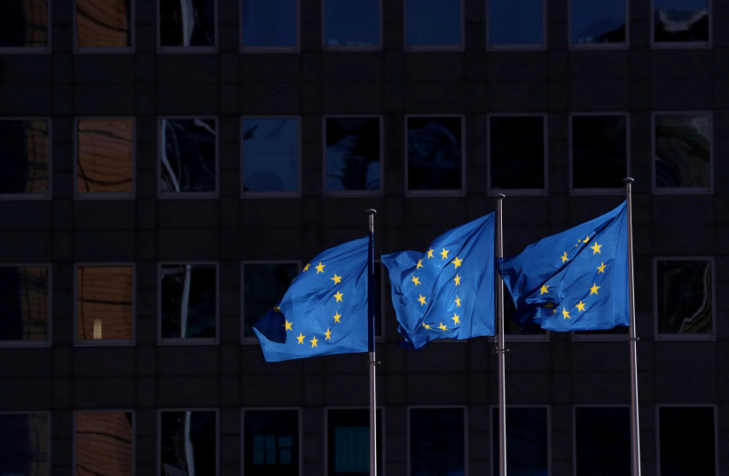 European Union flags fly outside the European Commission headquarters in Brussels (photo credit: YVES HERMAN/REUTERS)