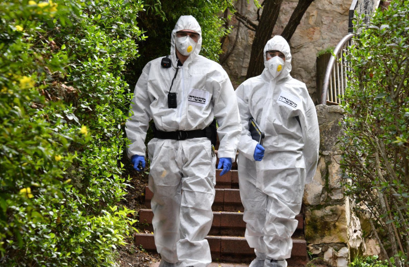 Police officers in coronavirus protective suits (photo credit: POLICE SPOKESPERSON'S UNIT)