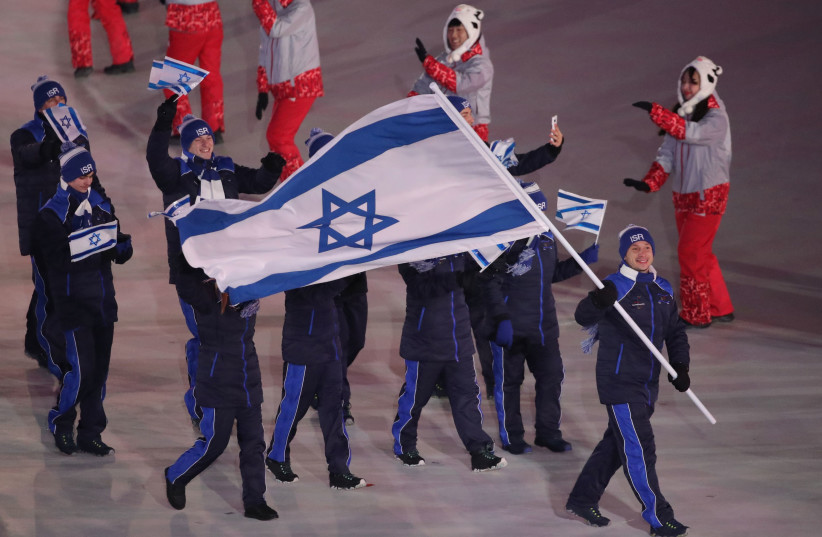 Pyeongchang 2018 Winter Olympics – Opening ceremony – Pyeongchang Olympic Stadium - Pyeongchang, South Korea – February 9, 2018 - Alexei Bychenko of Israel carries the national flag.  (photo credit: CARLOS BARRIA / REUTERS)