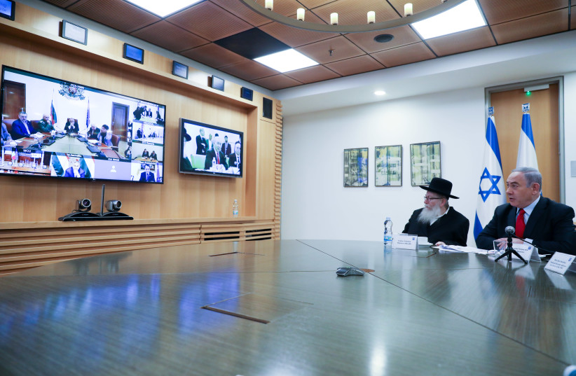 In a bid to stop the spread of the novel coronavirus, Prime Minister Benjamin Netanyahu and Health Minister Yaakov Litzman took part in a video conference with European officials on March 9. (photo credit: MARC ISRAEL SELLEM)