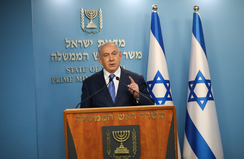 Prime Minister Benjamin Netanyahu threatened of a total lockdown as coronavirus infects 2,369 Israelis (photo credit: AMOS BEN-GERSHOM/GPO)