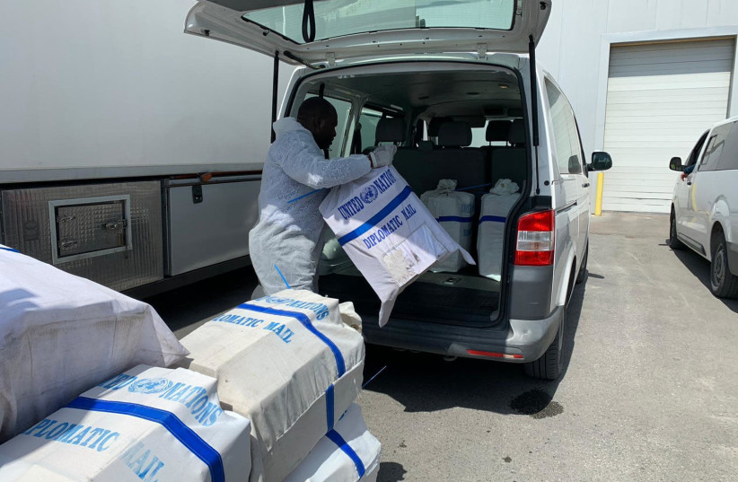 COGAT coordinates WHO delivery of coronavirus detection kits and protective masks to Palestinian Authority (photo credit: COGAT SPOKESPERSON'S OFFICE)