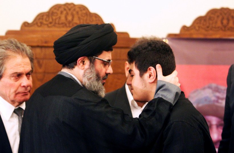 Sayyed Hashem Safieddine, head of the Hezbollah Executive Council, pays his condolences to Ali Badreddine, the son of top Hezbollah commander Mustafa Badreddine who was killed in an attack in Syria, in Beirut's southern suburb, Lebanon May 13, 2016.  (photo credit: AZIZ TAHER/REUTERS)