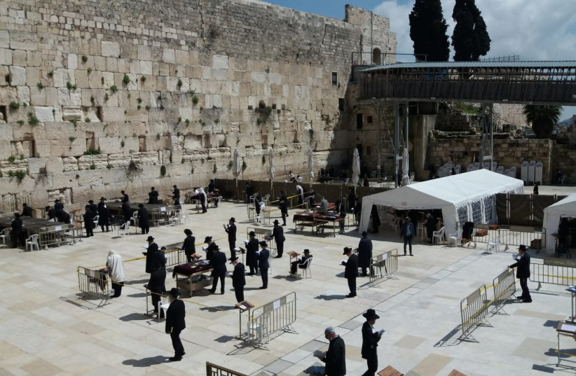 Worshipers at the Western Wall adhere to Health Ministry regulations by maintaining social distance.  (photo credit: THE WESTERN WALL HERITAGE FOUNDATION)
