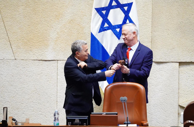 Amir Peretz gives newly-elected Knesset Speaker Benny Gantz the gavel on March 26, 2020 (photo credit: KNESSET SPOKESWOMAN - ADINA WALLMAN)