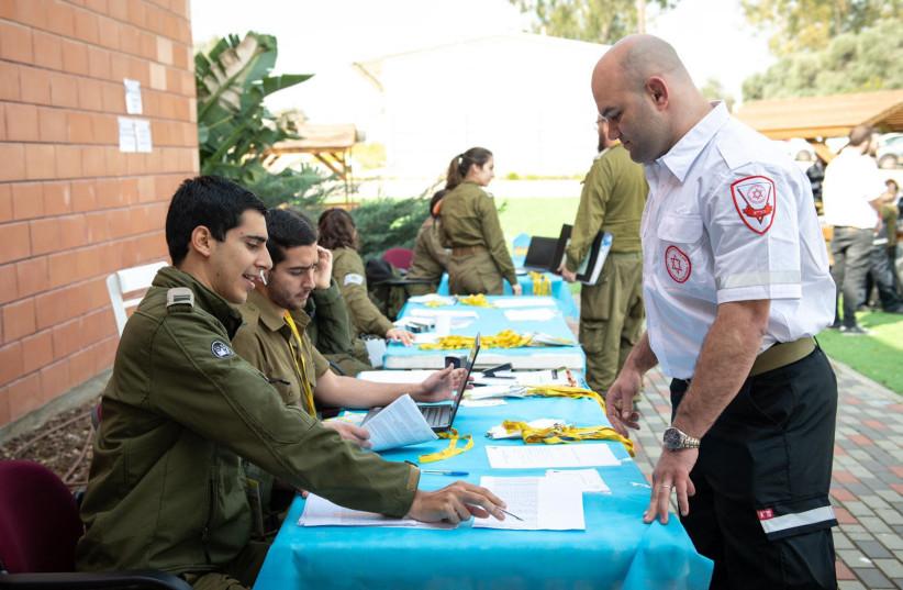 An IDF officer and Magen David Adom official speak (photo credit: IDF SPOKESPERSON'S UNIT)