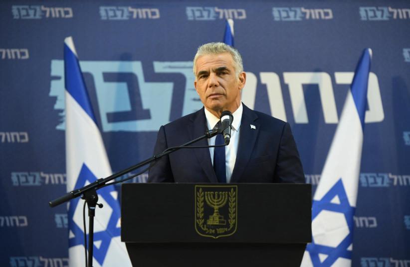 Yair Lapid speaking on March 26, 2020 (photo credit: ELAD GUTTMAN)
