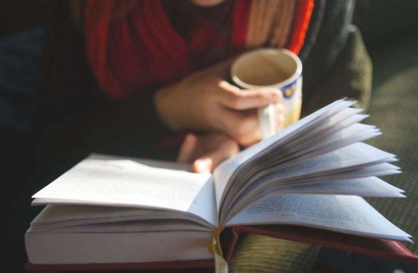 Reading a book (Illustrative) (photo credit: WALLPAPER SAFARI)