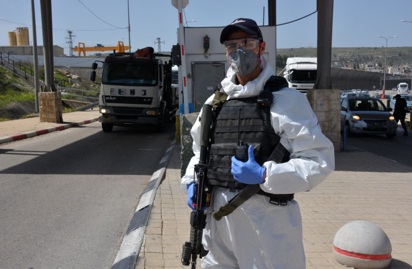 Border police officer wears protective gear at a checkpoint (photo credit: ISRAEL POLICE)