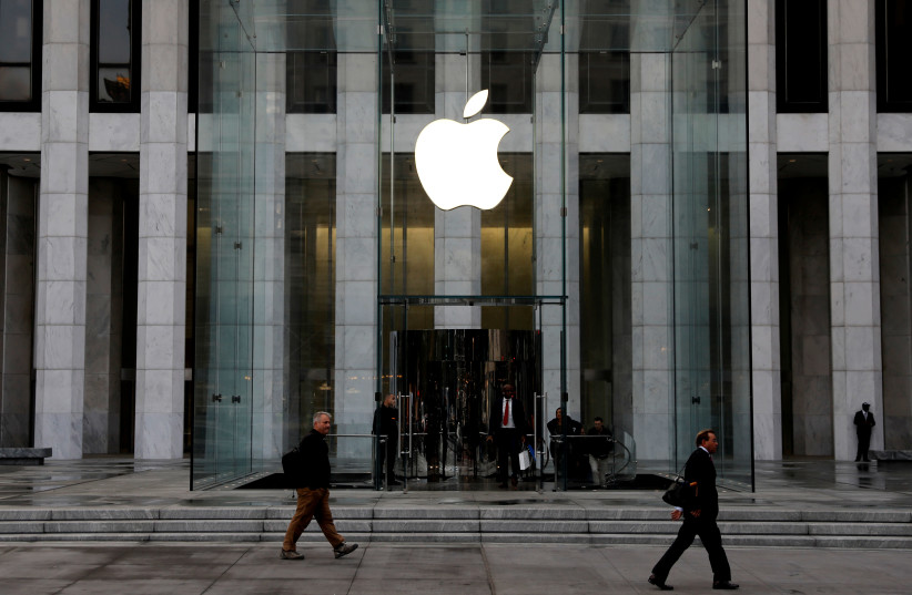 FILE PHOTO: The Apple Inc. logo is seen hanging at the entrance to the Apple store on 5th Avenue in Manhattan, New York, U.S., October 16, 2019 (photo credit: REUTERS/MIKE SEGAR/FILE PHOTO)