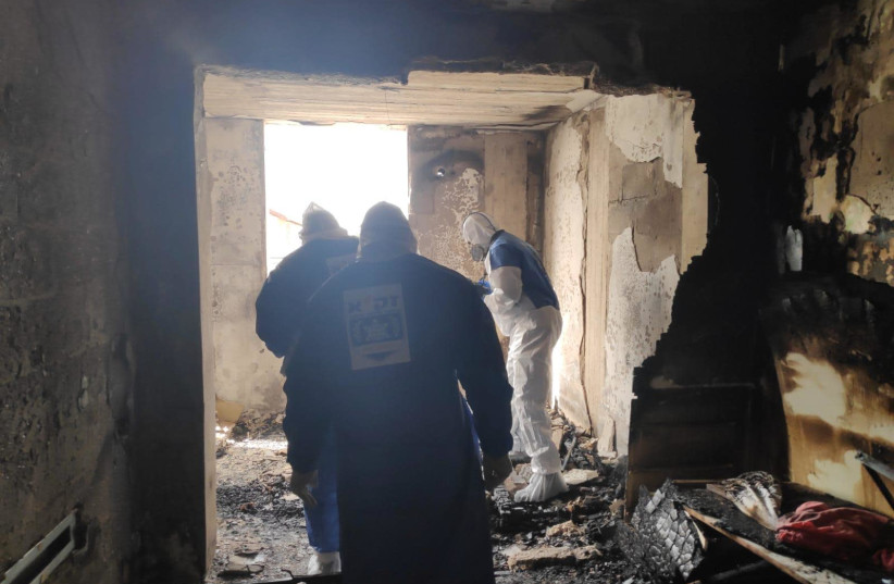 Firefighters inspect the aftermath of a fire, Petah Tikva, March 30, 2020 (photo credit: ZAKA)