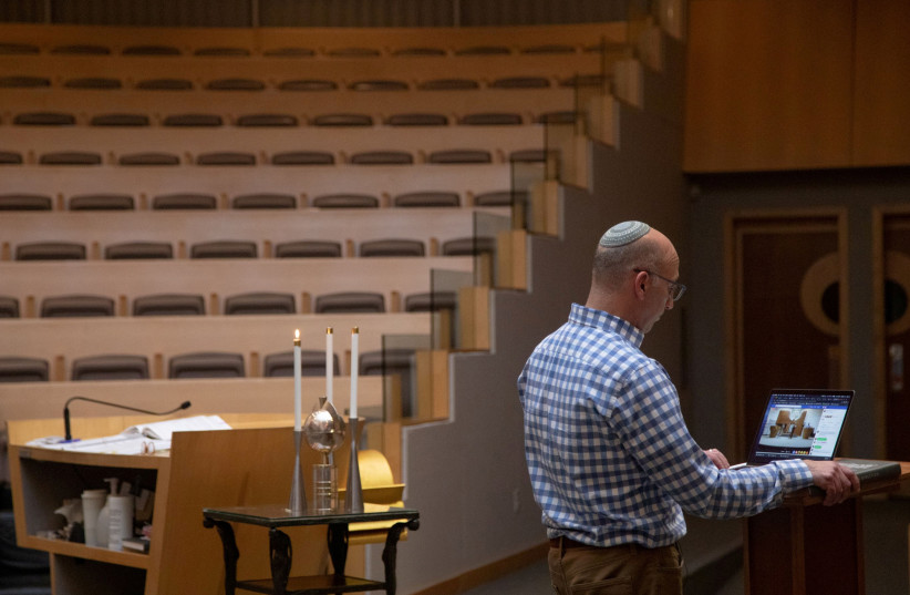 Prayers are livestreamed from inside Temple Shir Shalom (photo credit: REUTERS)