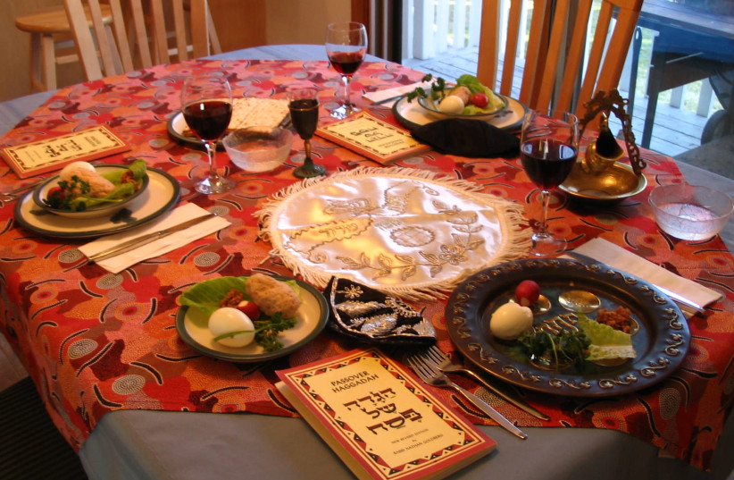 A SUGGESTION for the Seder: Leave an empty chair at the table for the person who cannot attend, but at the empty place setting, includes items they would have brought. (photo credit: Courtesy)