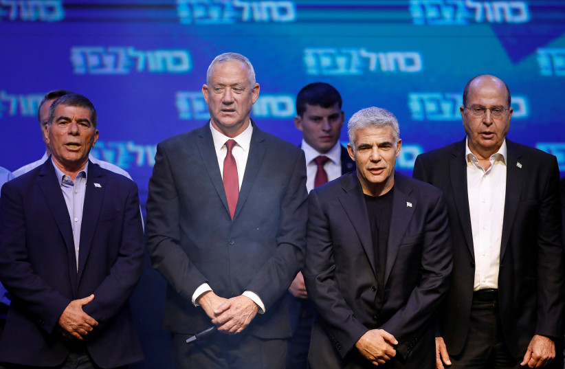Before the split: (From left) Blue and White leaders Gabi Ashkenazi, Benny Gantz, Yair Lapid and Moshe Ya'alon thank supporters at party headquarters in Tel Aviv after the elections on September 18, 2019 (photo credit: AMIR COHEN/REUTERS)