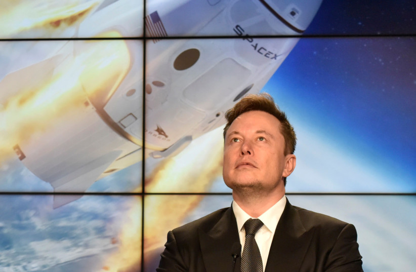 SpaceX founder and chief engineer Elon Musk attends a post-launch news conference to discuss the SpaceX Crew Dragon astronaut capsule in-flight abort test at the Kennedy Space Center (photo credit: REUTERS)