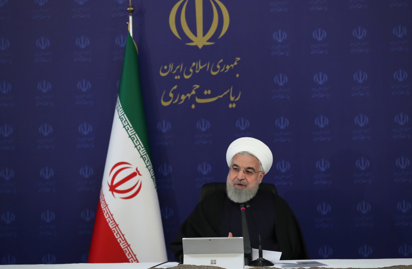 ranian President Hassan Rouhani speaks during the cabinet meeting, as the spread of the coronavirus disease (COVID-19) continues, in Tehran, Iran, April 1, 2020. (photo credit: REUTERS)