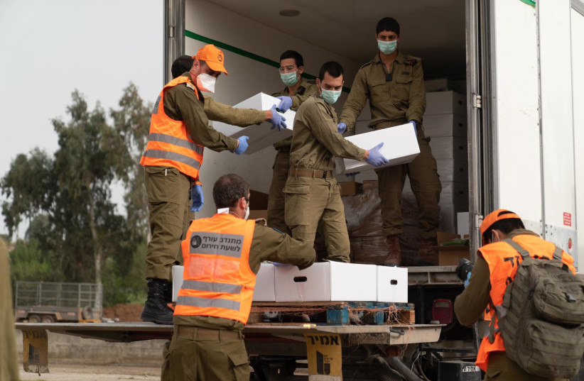 Soldiers of Israel's Home Front Command deliver food parcels to Bnei Brak, currently under coronavirus lockdown, April 5, 2020 (photo credit: IDF SPOKESPERSON'S UNIT)